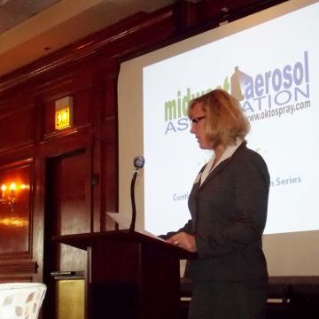 Deborah speaking at event