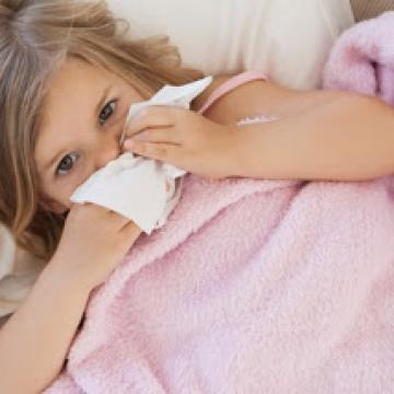 Young girl with a cold