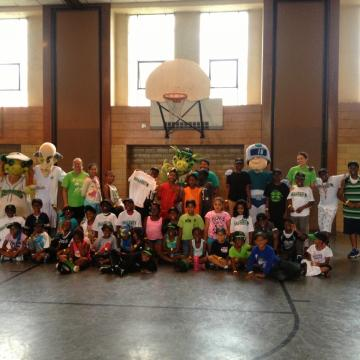 ACE mascots with kids at Dayton