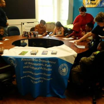 Kids gathering around table for NIPAW 2014