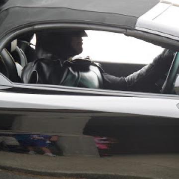 Batman driving a Chevy Camaro