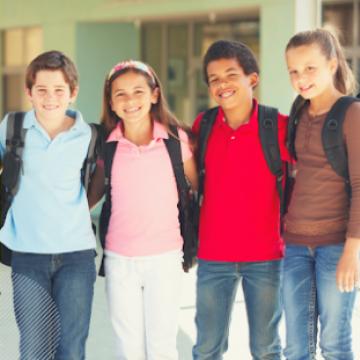 Four Friends wearing backpacks